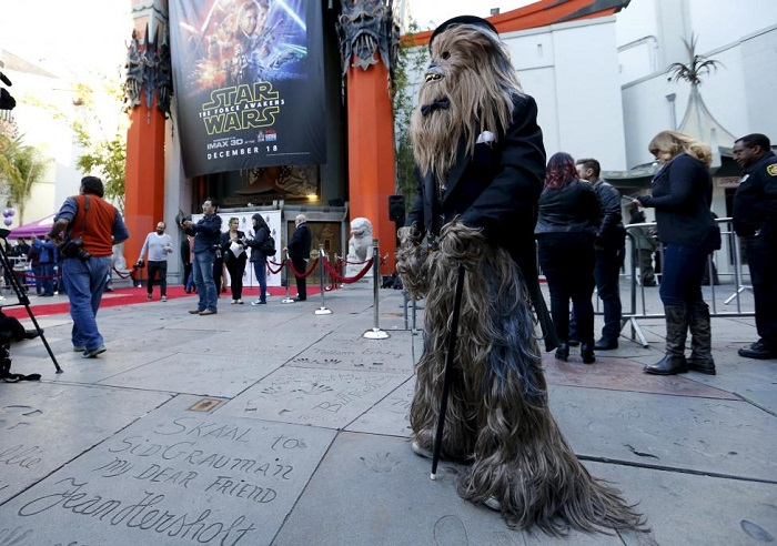 Anthony Troli, dressed as the character of Chewbacca, waits before a Star Wars themed wedding in the forecourt of the TCL Chinese Theatre in Hollywood, California December 17, 2015. REUTERS/Mario Anzuoni