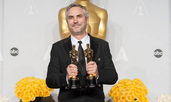 """After winning his second Oscar® for the night for work on """"Gravity"""", director Alfonso Cuarón poses with his Oscar® for the press. The Oscars® are presented live on ABC from the Dolby® Theatre in Hollywood, CA Sunday, March 2, 2014."""