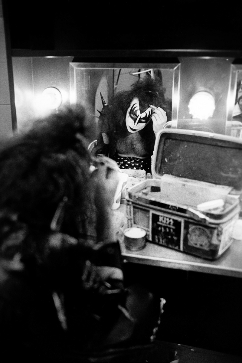 UNITED STATES - MAY 16:  Photo of KISS and Gene SIMMONS; Gene Simmons backstage in dressing room putting on make up,  (Photo by Fin Costello/Redferns)