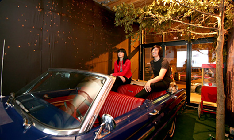 Artist Kevin Fey and his sister Lydia sit in a car and watch a movie in a storefront lounge, called DRV-IN, Saturday, September 15, 2007, in the Lower East Side of New York. The design space, called Grand Opening, is run by Canadian brothers Ben and Hall Smyth and will change concepts every three or four months. (Photo by Diane Bondareff for The Toronto Star)