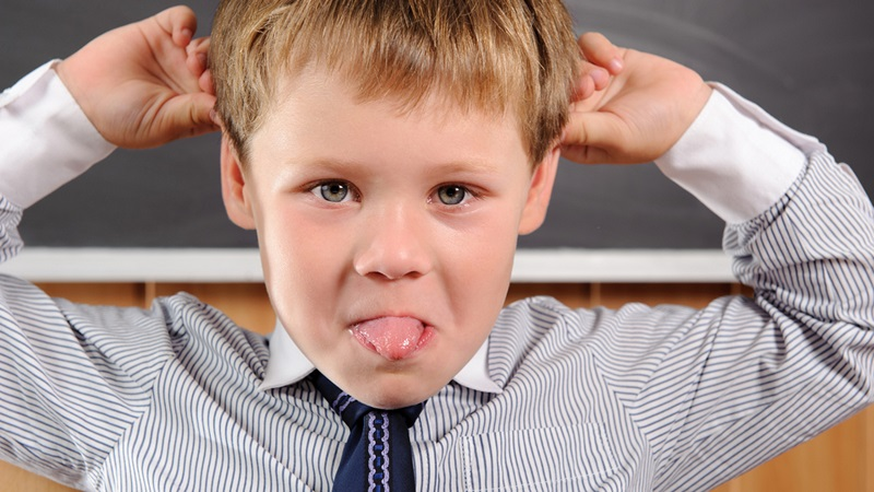 Funny preschool aged boy fooling in classroom; Shutterstock ID 109983830; PO: TODAY.com