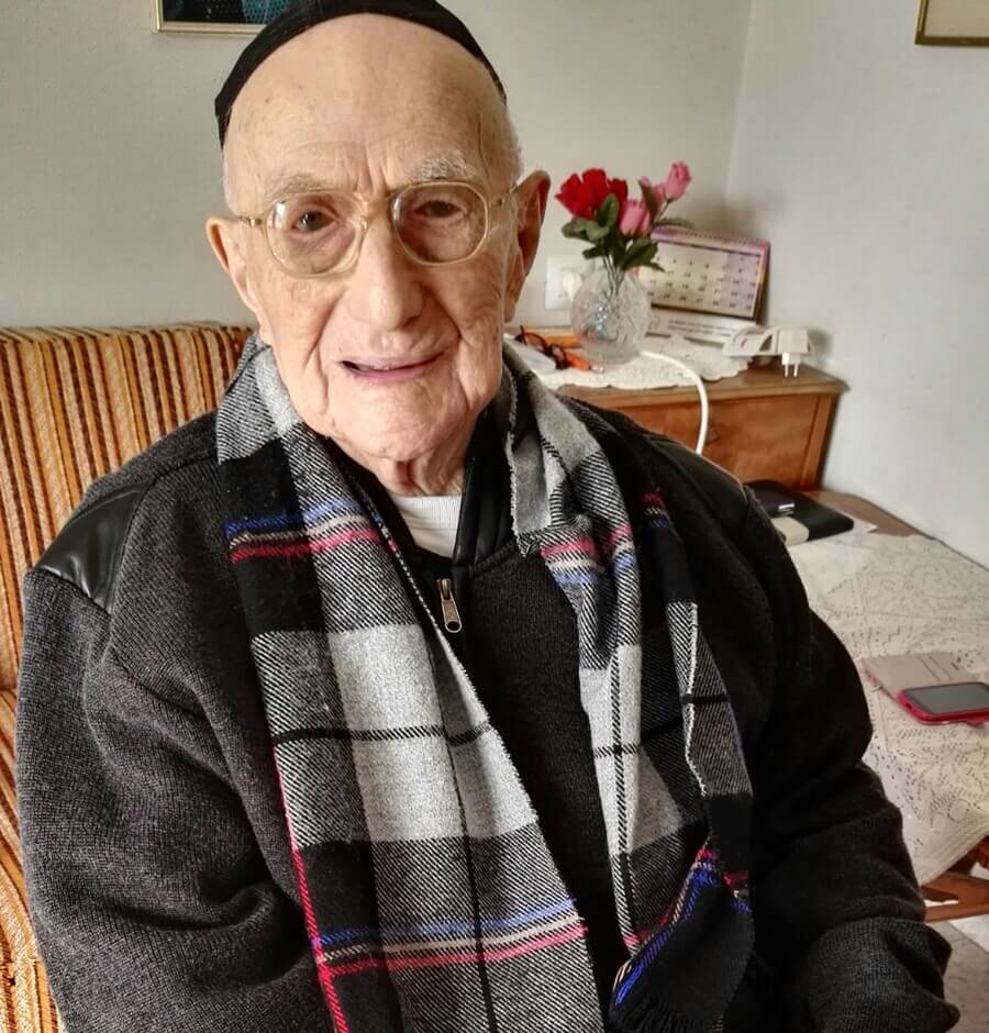 A picture taken on January 21, 2016, shows Yisrael Kristal sitting in his home in the Israeli city of Haifa. Yisrael, an Israeli Holocaust survivor, may be the world's oldest man at 112, Guinness World Records said, providing he can find the documents to prove it. His family say he was born in Poland on September 15, 1903, three months before the Wright brothers took the first aeroplane flight.  / AFP / SHULA KOPERSHTOUK