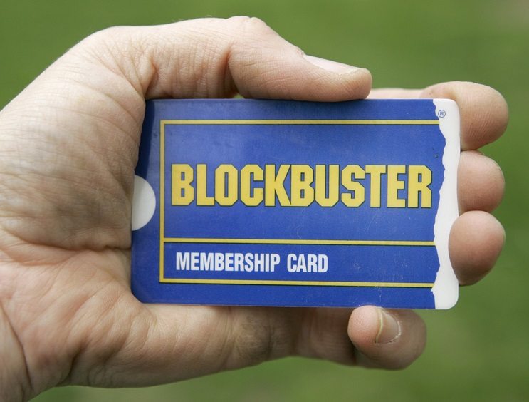 ** FILE ** In this May 9, 2008 file photo, a customer holds her membership card outside a Blockbuster video store in Woodmere, Ohio. Blockbuster Inc.'s second-quarter loss deepened Thursday, Aug. 7, 2008, but the struggling movie rental chain showed some signs of progress by wringing more revenue from its stores while lowering its costs. (AP Photo/Amy Sancetta, file)