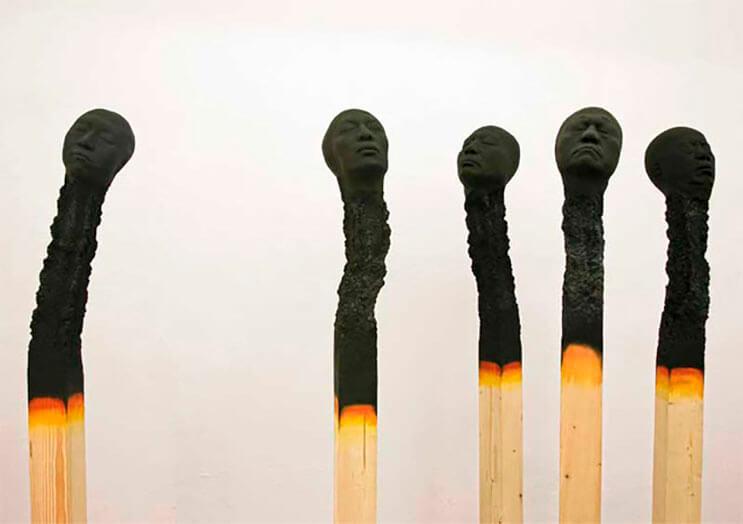Creatividad absoluta Palillos de fósforo a gran escala con rostros humanos 3