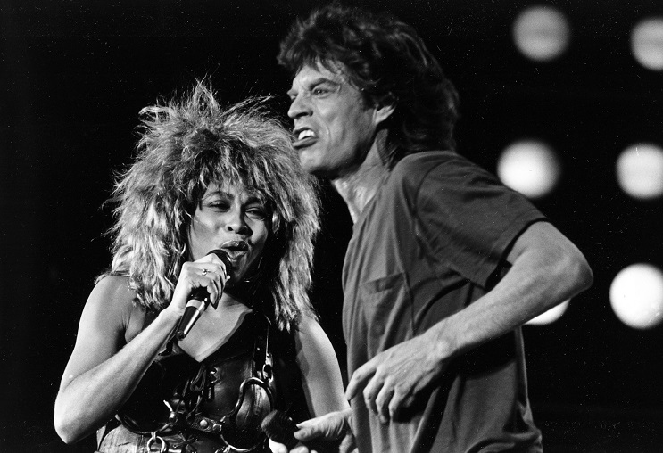 Tina Turner, left, and Mick Jagger perform together at the Live Aid concert at Philadelphia's J.F.K. Stadium, on July 13, 1985. (AP Photo/Rusty Kennedy)