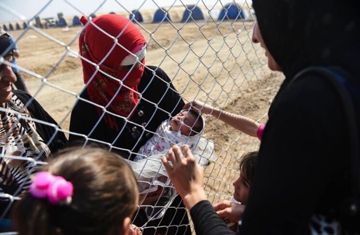 emotivas-fotografias-de-familias-reencontrandose-en-irak-1