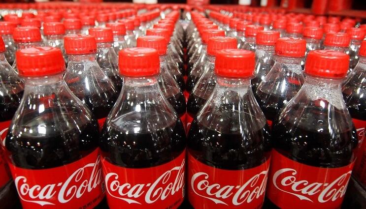 botellas-de-coca-cola-con-mensajes-personalizados-en-sus-tapas-chapas