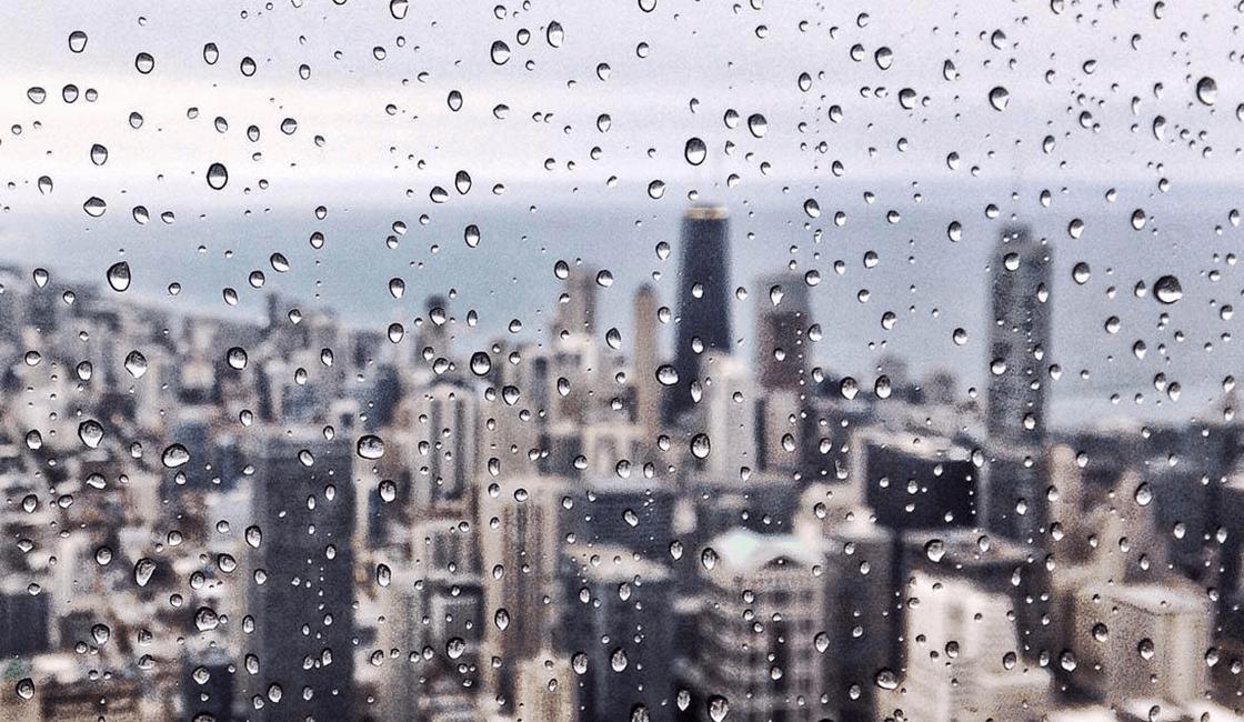 Tomale-foto-a-un-paisaje-urbano-para-fotografía-de-lluvia